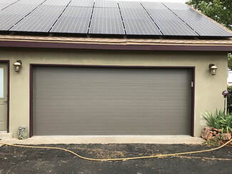 5 Reasons to Contact Your Local Garage Door Repair Expert - Plank Style Door with Bronze Finish