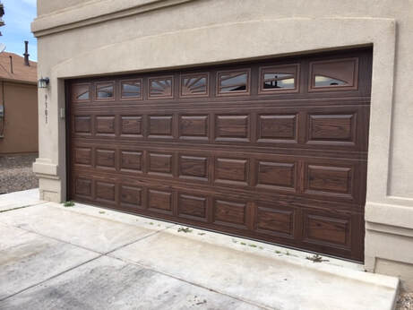 5 Reasons to Contact Your Local Garage Door Repair Expert - Short Raised Panel with Dark Oak Finish
